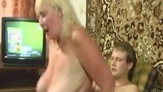 A blonde granny enjoys having a penetration