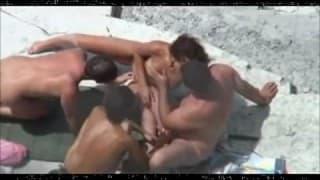Amateur hidden camera films couples on nudist beach
