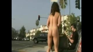 Young and free brunette takes a naked stroll