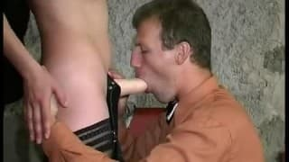 Guy sits on her strap on dildo in chair