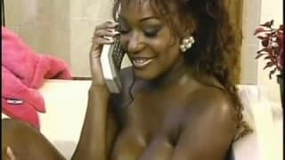 A busty ebony takes care of her white boy
