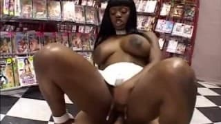 A big black woman is fucked in a sexshop