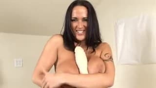 Carmella Bing strumming herself with huge dildo