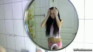Plunging into Herself in the Bathroom