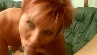 A big mature woman pleasures herself with a dick in her mouth
