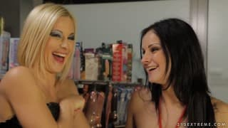 Emma and Abbie Cat- Two lesbians using strap-on dildos