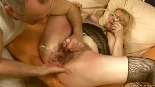 A mature woman enjoys a lot of sex toys