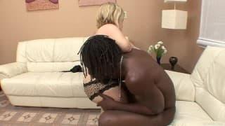 Stella Marie climbs a black guy