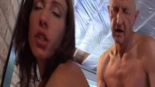 Suzie sucks the penis of an old man