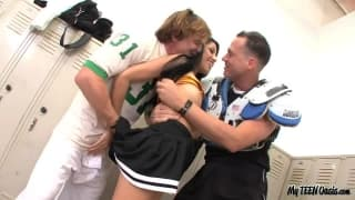 A cheerleader fucked by  two players in a threesome