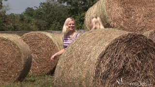 Blond Cat and Yasmine Gold are touching in the country