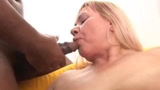 A mature woman sucking a black cock