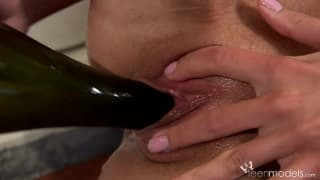 Blonde babe Kate A masturbates with a wine bottle