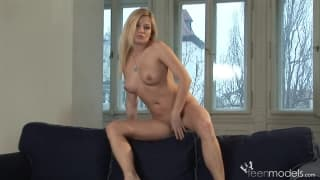 This sexy blonde strips and caresses herself
