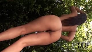Eve Angel plays with herself outside