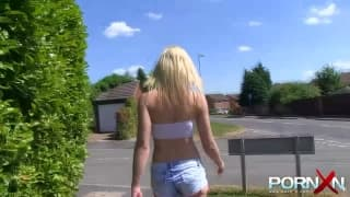 Blonde slut flashes her tits in public