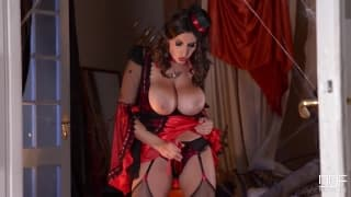 This sultry brunette masturbates in a costume