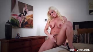A masturbation scene with a busty blonde
