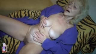 This old granny plays with her pussy