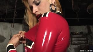 This blonde shemale shows her latex outfit
