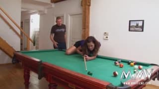 A brunette fucking on a pool table