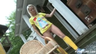 Sweet blonde masturbates in the garden