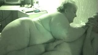 This fat blonde bitch fucks in bed with a guy