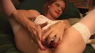 This slut has gigantic dildos in her pussy