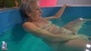 Grandma enjoys a swim before masturbating