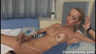 A horny Latin shemale wanks off happily