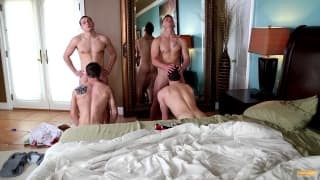 Four muscular gay men fuck together