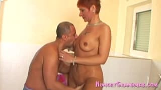 A fiery redhead grandma giving head