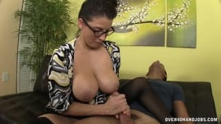 A busty woman is jerking off this cock