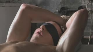 Jake is tied down and pleasured by a handjob