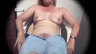 A mature slut is spied on whilst masturbating
