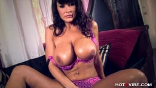 Lisa Ann gives herself an orgasm here