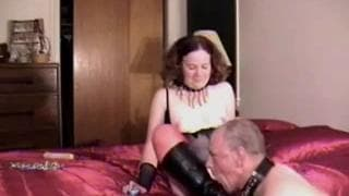 A milf who is seducing her husband in bed
