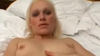 A naughty blonde masturbates with her panties