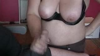 Mature busty wife gives a handjob to her man!