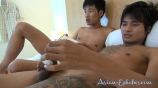 Two young Asian gays have a good time