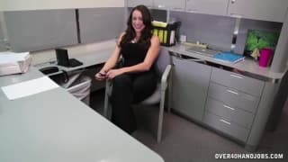 Sexy bombshell gives a handjob in the office