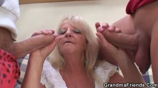 A blonde granny sucks off two young guys