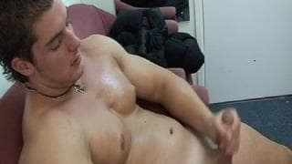 A gay stripper enjoys masturbating.