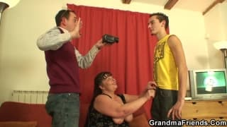 A mature woman enjoys her two young men