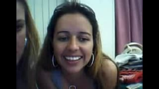 Two young women iin frint of the webcam