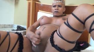 Mel Pinheiro masturbates her cock happily