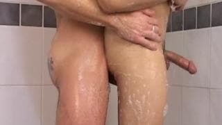 A gay couple shagging in the shower
