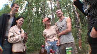Two beautiful sluts in a camping orgy