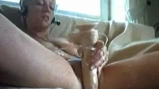 A mega horny slut with a dildo on camera!