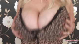 Angel is a very busty woman with a dildo